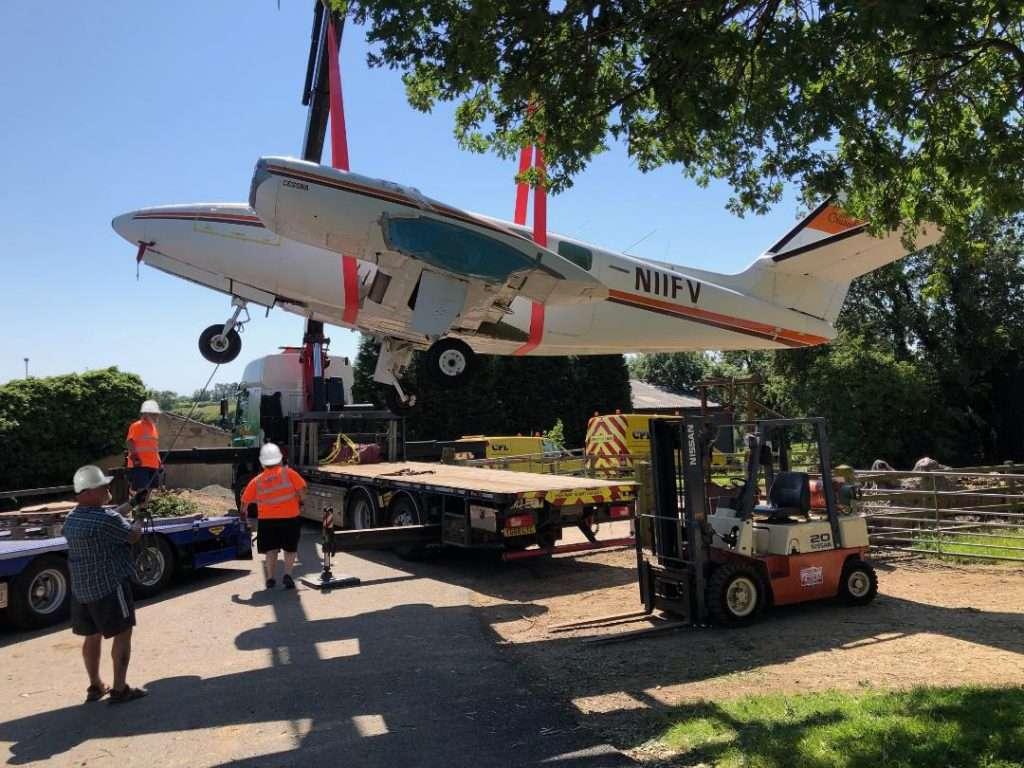 Lifting a Cessna fuselage 1- K Transport Services